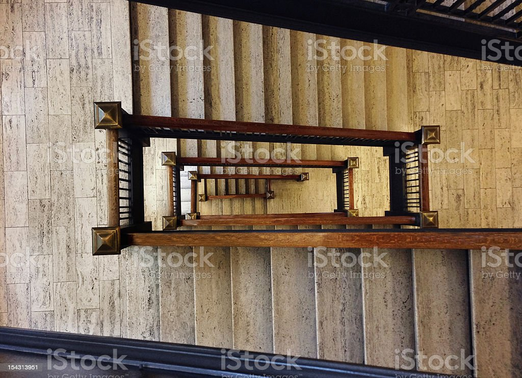 Old marble staircase looking downward stock photo