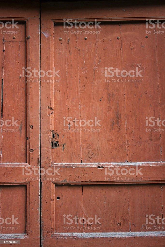 Old maroon wooden door royalty-free stock photo