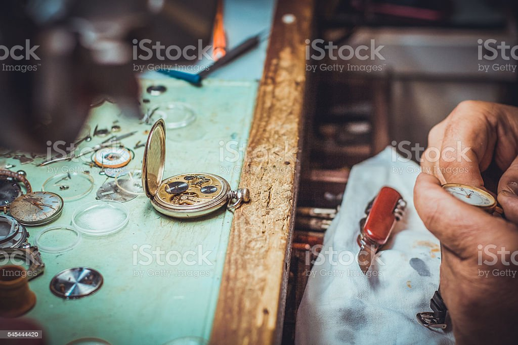 old mechanical watch on watchmaker table stock photo
