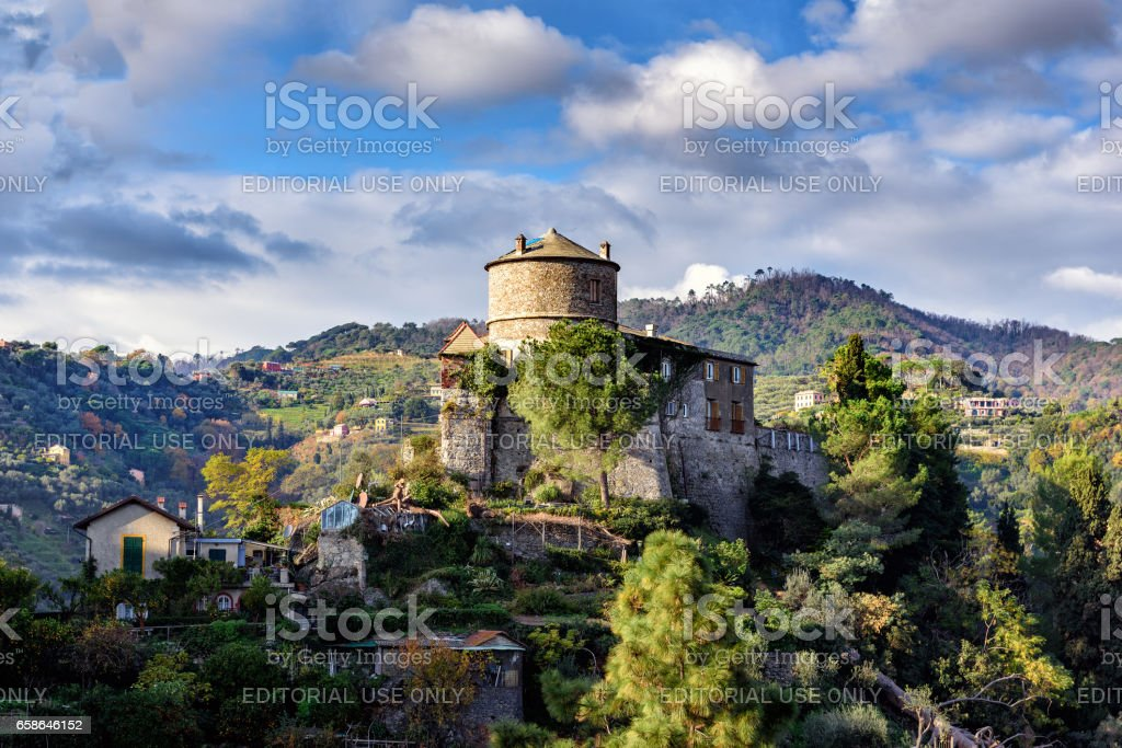 Old medieval castle, located on a hill near harbor, Italy stock photo