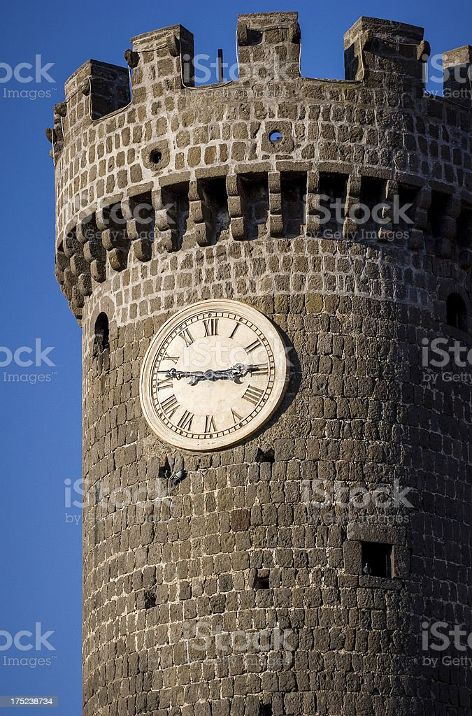 Old medieval clock tower stock photo