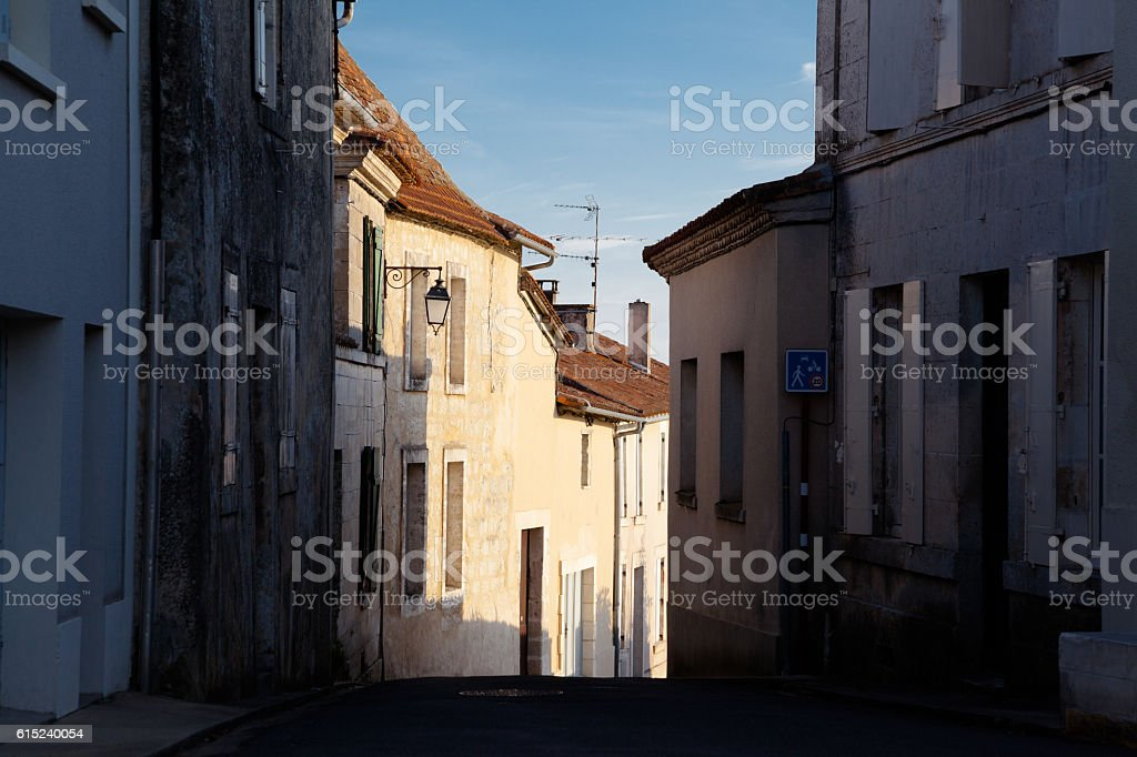 old medieval cobbled street historic  french village of Aubeterre stock photo