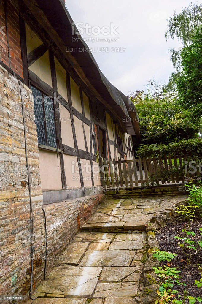 Old Medieval Cottage Home and Garden stock photo