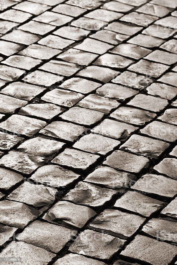 Old medieval granite cobble road royalty-free stock photo