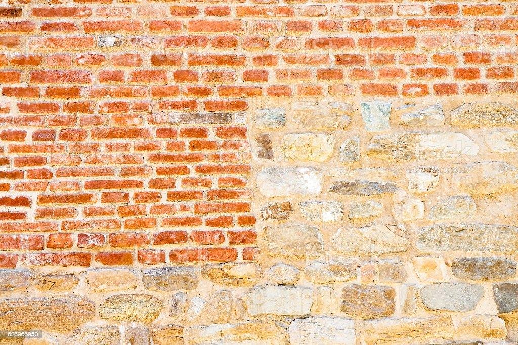 Old medieval italian stone and brick wall stock photo
