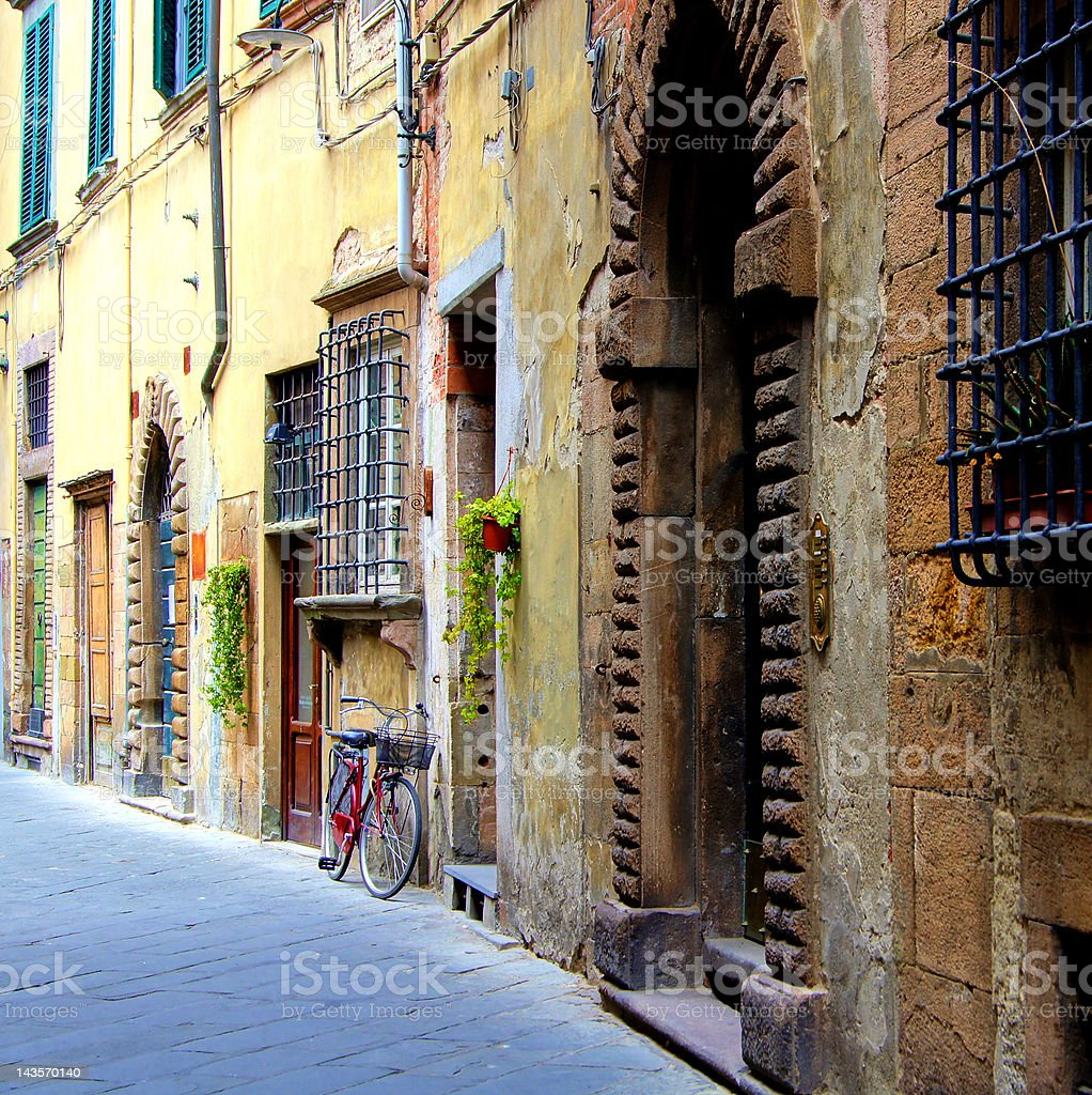 Old medieval street in Italy stock photo