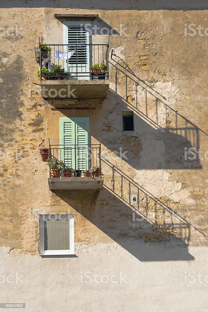 Old  Mediterranean Wall with Windows and Balcony royalty-free stock photo