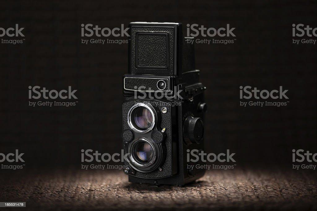 Old medium format camera under a spot light royalty-free stock photo