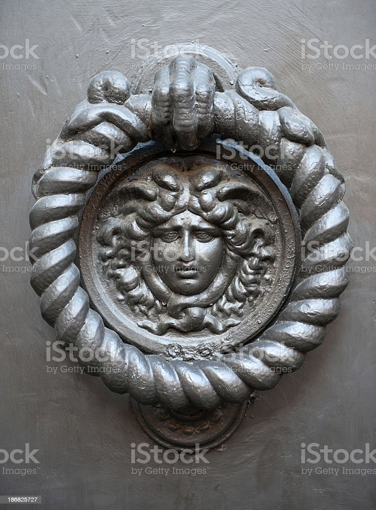 Old Medusa Doorhandle in Rome royalty-free stock photo