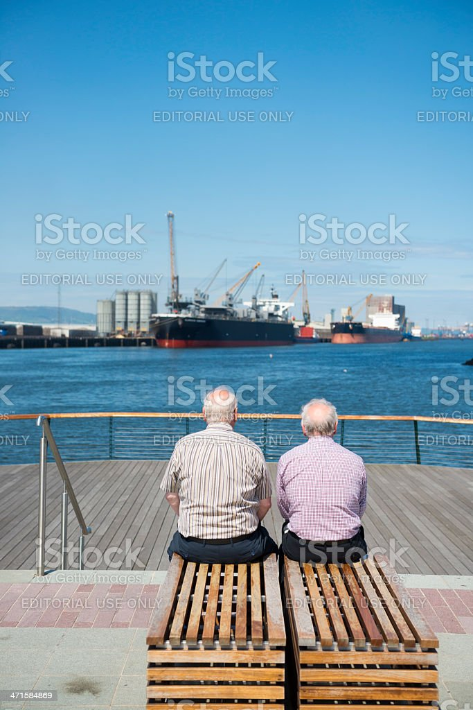 Old men and the sea in Belfast, Northern Ireland royalty-free stock photo