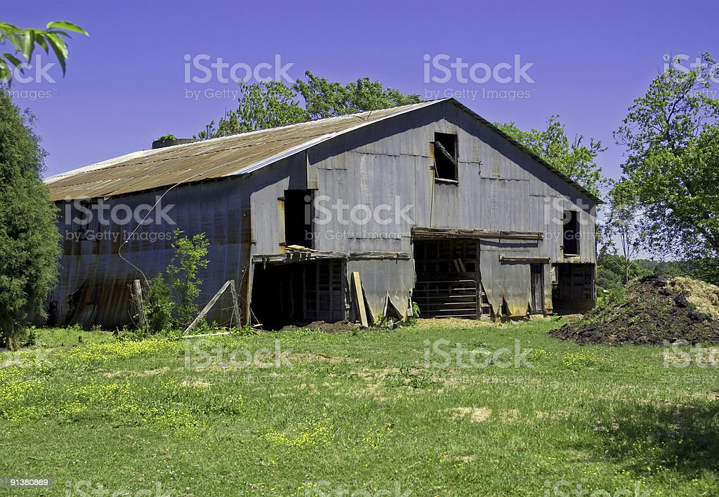 Old Metal Barn in the Spring royalty-free stock photo
