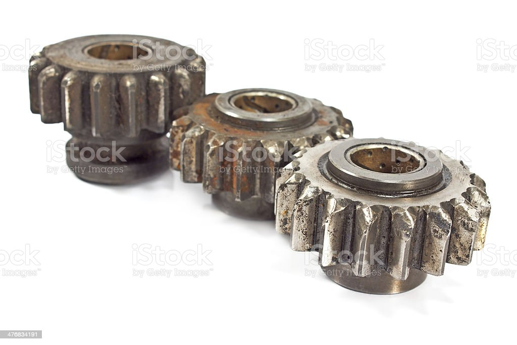 Old metal cogs isolated on white royalty-free stock photo