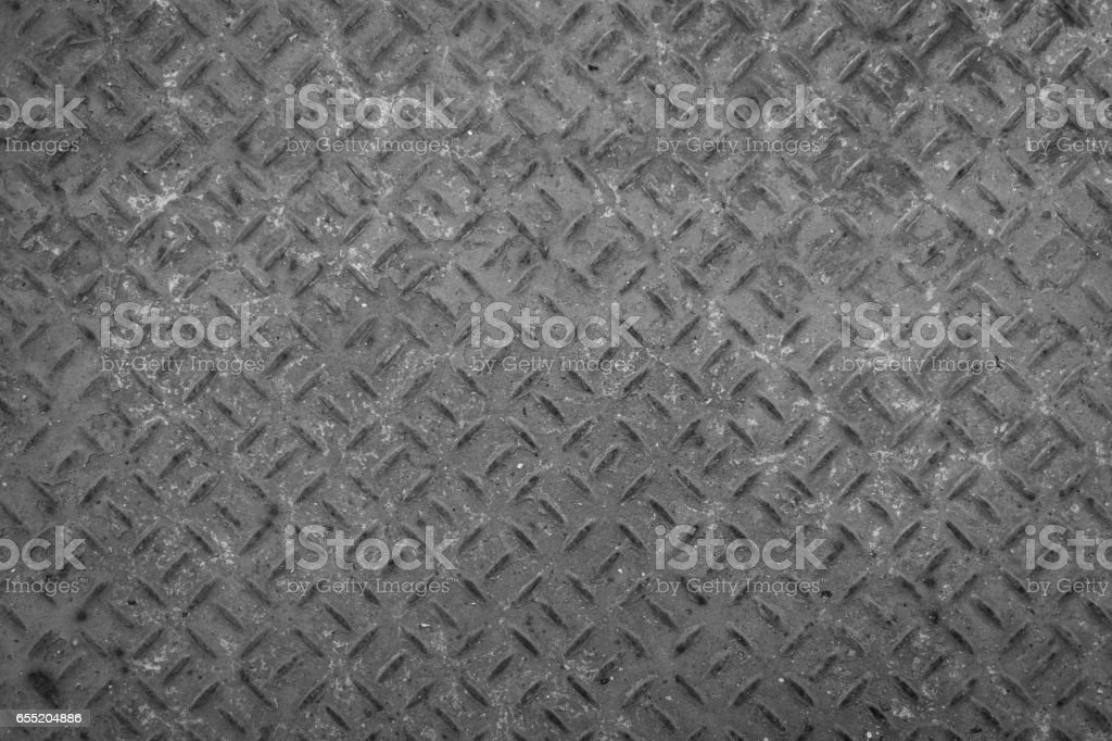 Old metal floor plate with diamond pattern and rusty background texture. stock photo