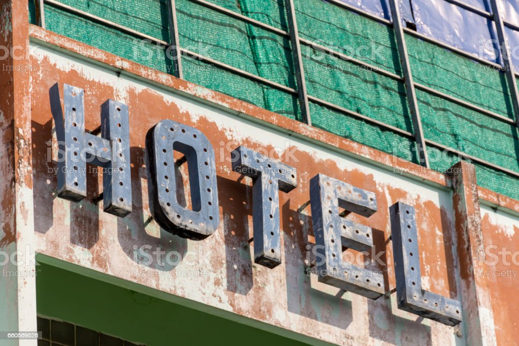 Old metal Hotel sign in need of repair stock photo