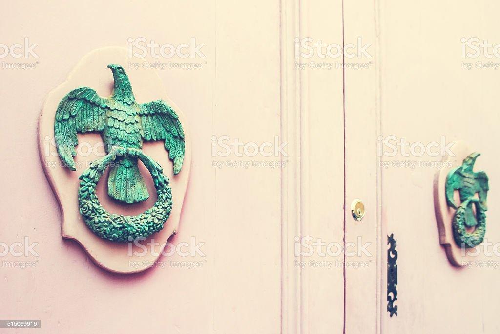 Old Metal Knockers on Wooden Pink Door in Mdina, Malta stock photo