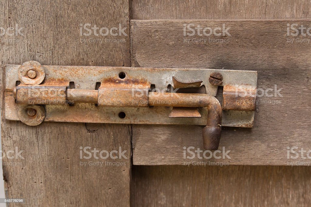 Old metal lockon the wooden surface of the ancient door stock photo