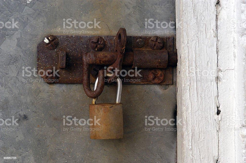 old metal pad locked door stock photo
