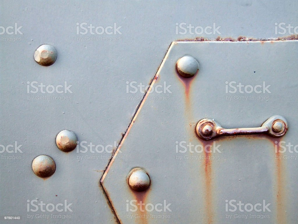 Old metal plate with bolts royalty-free stock photo