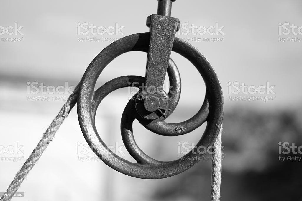 Old metal pulley stock photo