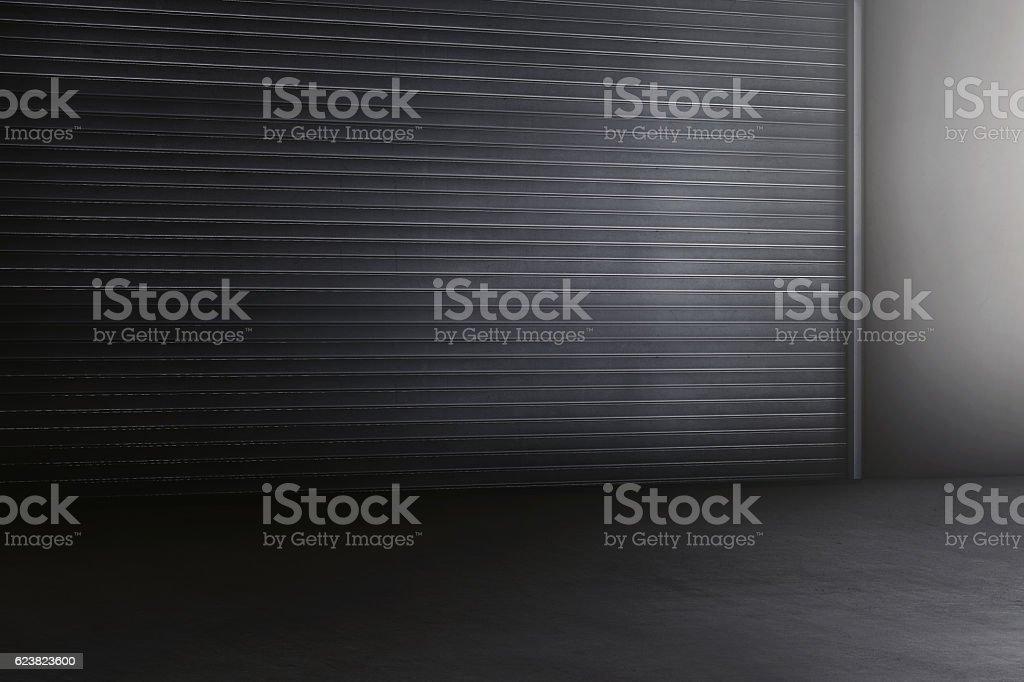 Old metal rolling door in dark style stock photo