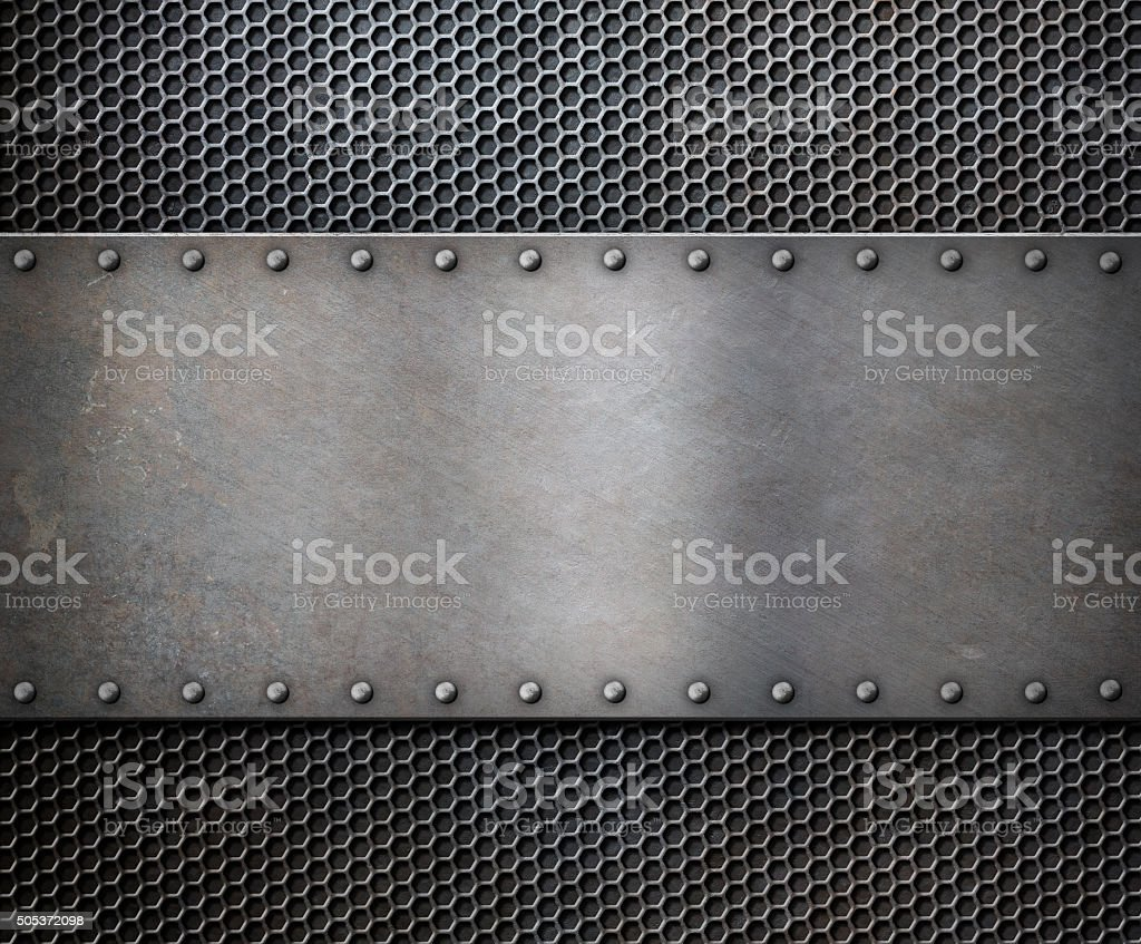 old metal rustic plate over grid background stock photo