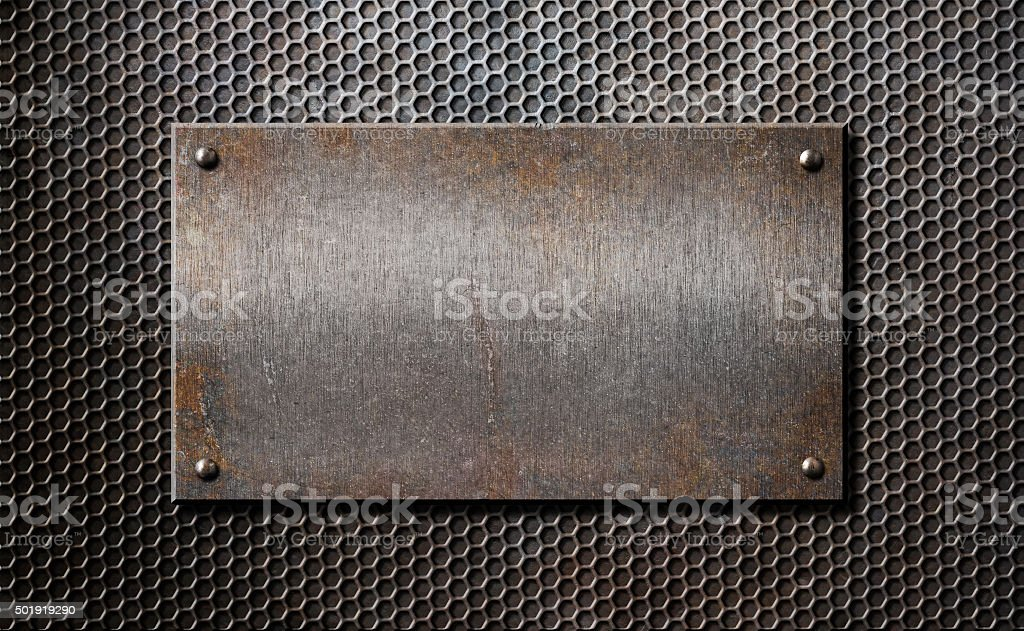 old metal rusty or rustic plate over comb grid background stock photo