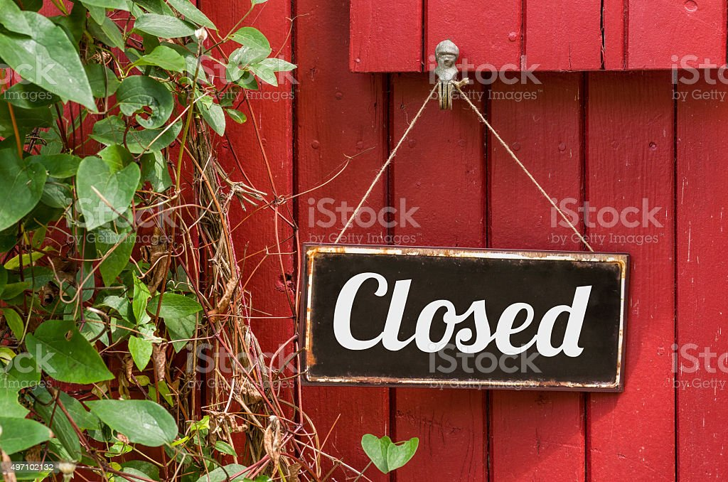 Old metal sign with the inscription Closed stock photo