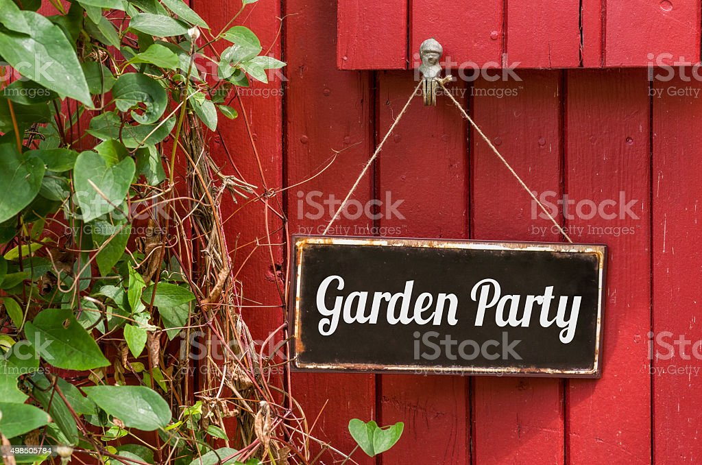 Old metal sign with the inscription Garden Party stock photo