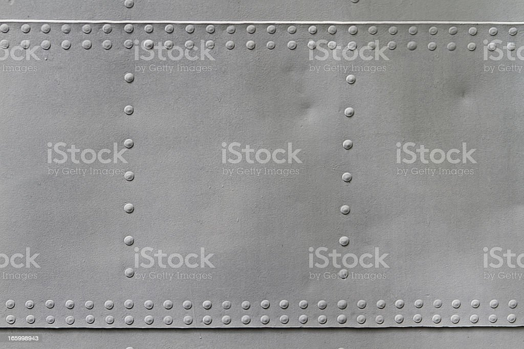 old metal texture with rivets stock photo