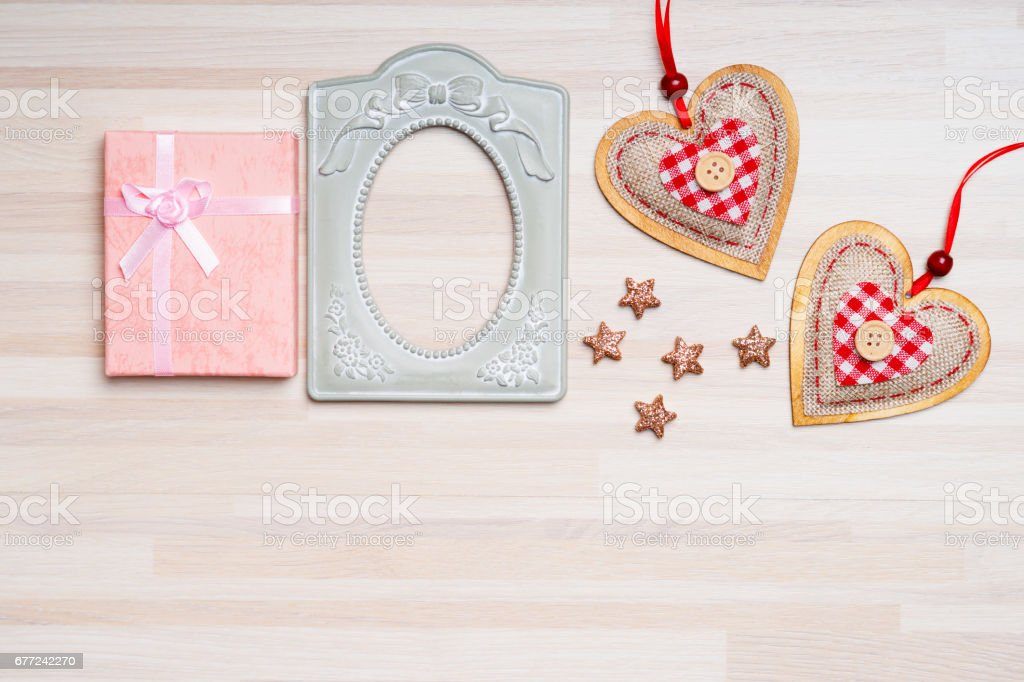 Old metallic picture frame, gift box, stars and heart shapes stock photo