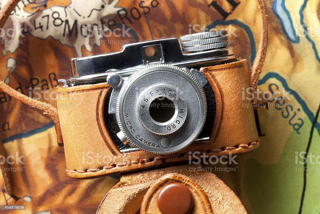 Old micro camera on map royalty-free stock photo