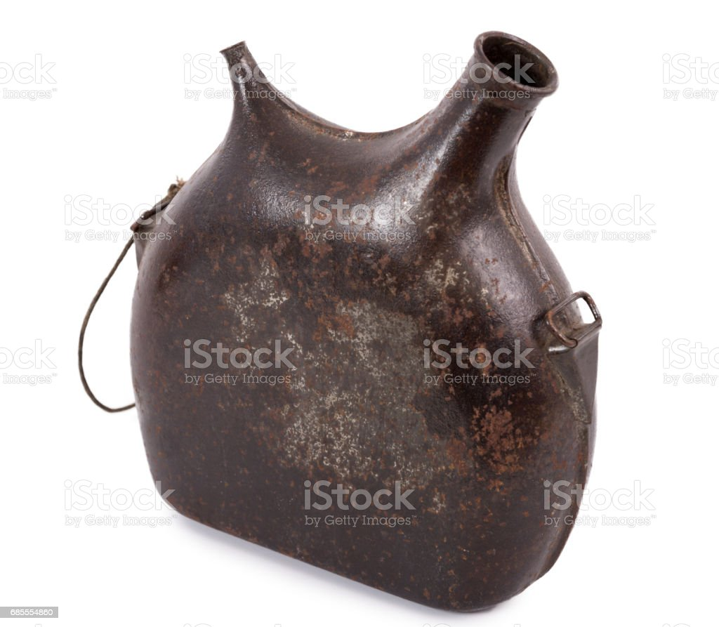 Old military canteen isolated on a white background stock photo