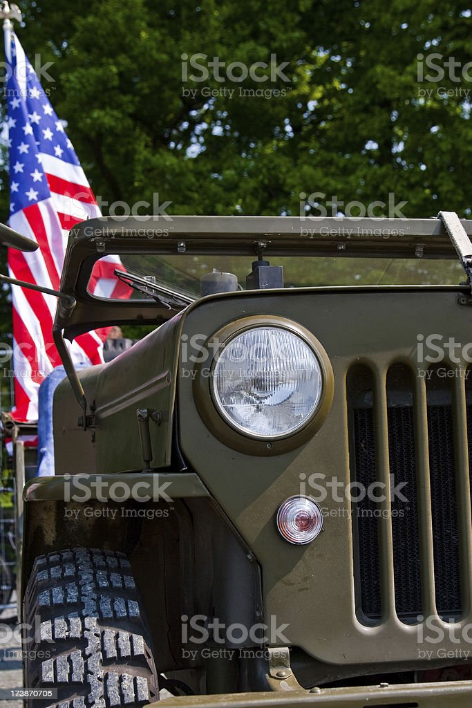 Old Military Car with American Flag stock photo