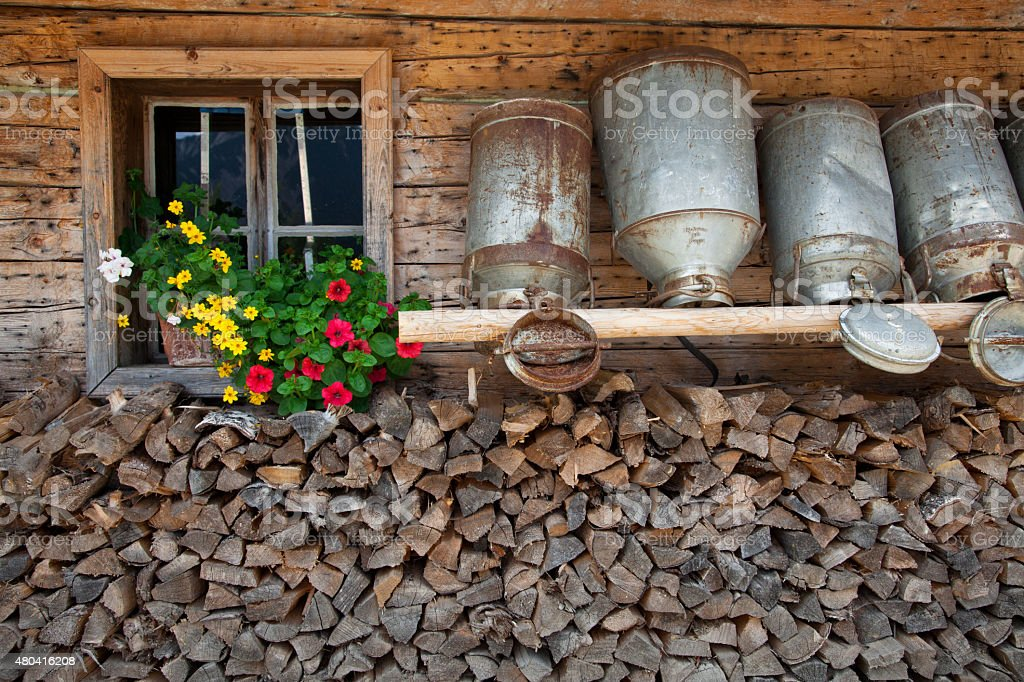 Old milk cans in a alpine hut stock photo