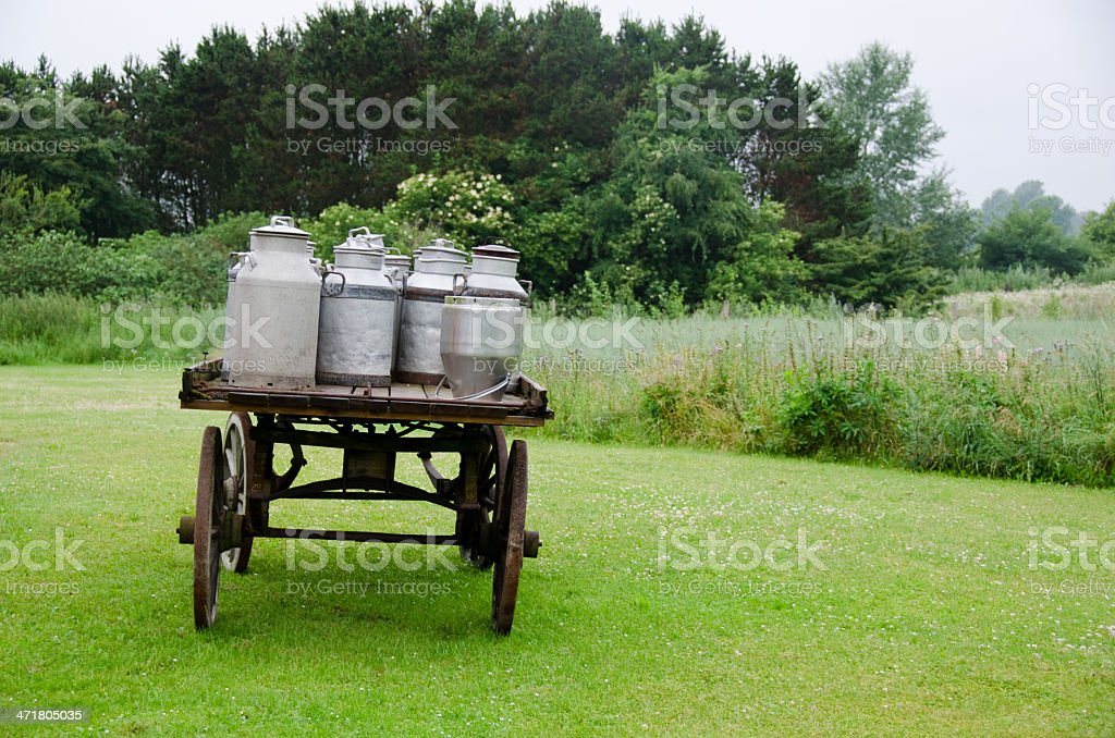 Old milk cans on waggon royalty-free stock photo