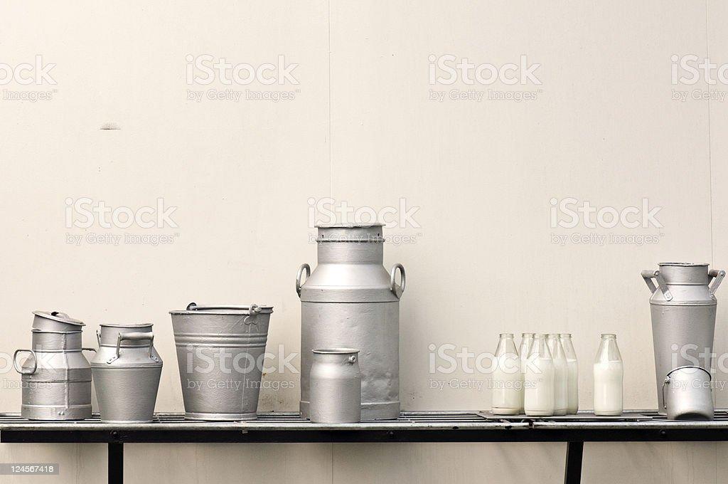 Old milk jugs stock photo