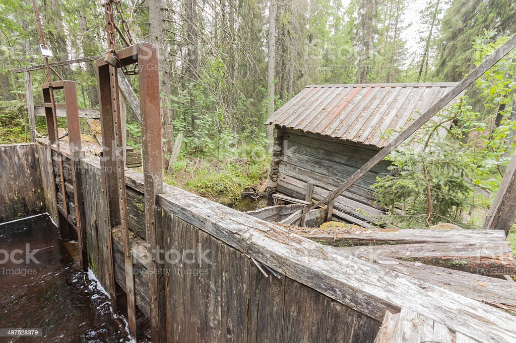 Old mill and its flood gates royalty-free stock photo