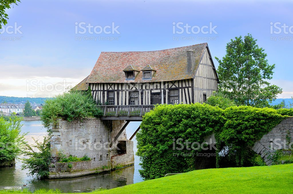 Old mill house on bridge, Seine river, Vernon, Normandy stock photo