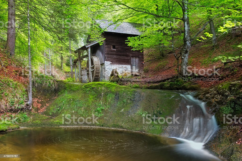 Old Mill in European Alps at springtime stock photo