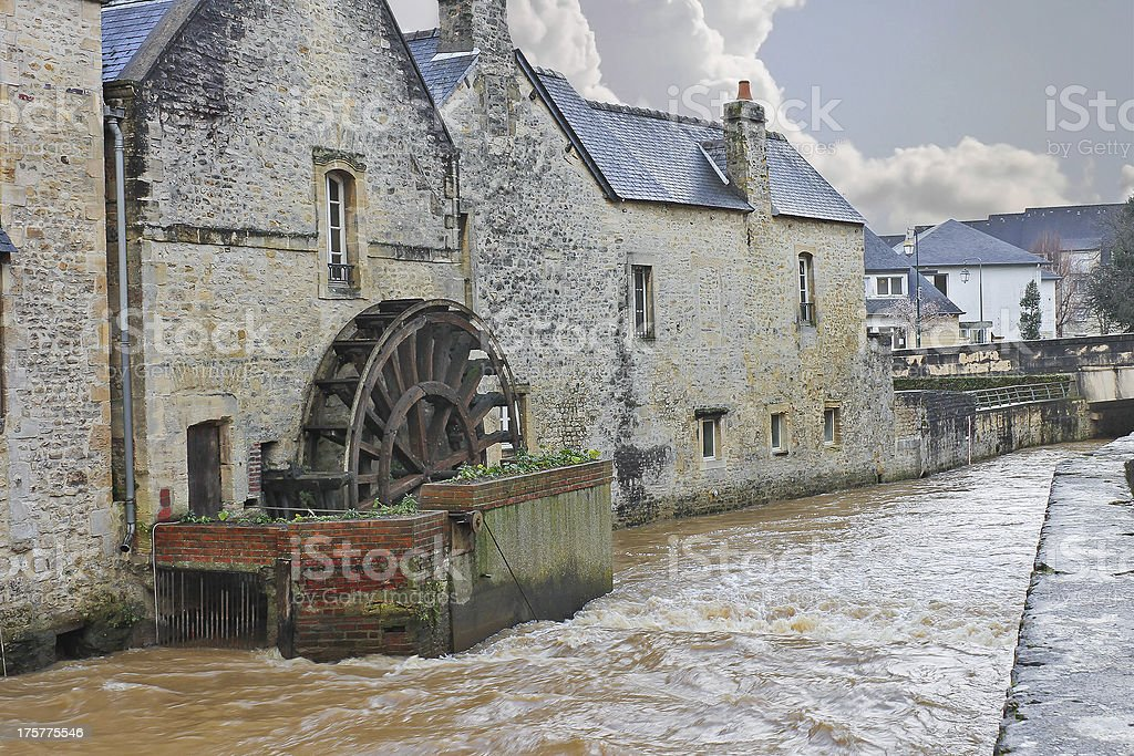Old mill on river in the town of Bayeux. stock photo