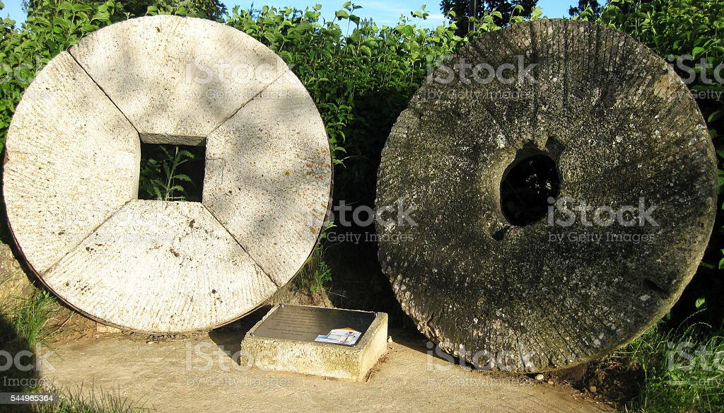 Old mill stones . stock photo