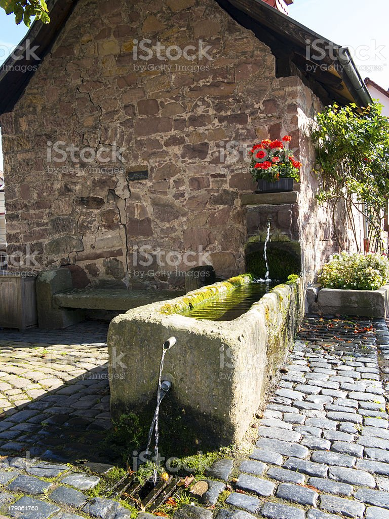 old mill with water basin in fairy tale town stock photo