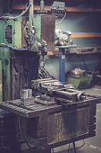 Old milling machine and vice in the workshop