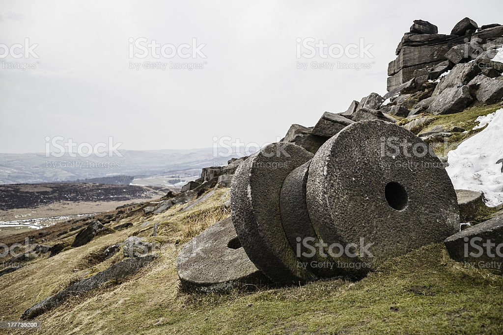 Old millstones in Peak District National Park stock photo