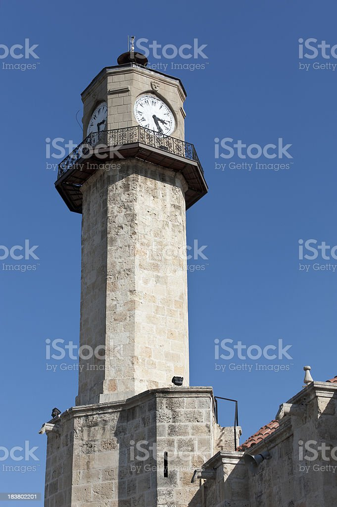 Old minaret with clock stock photo