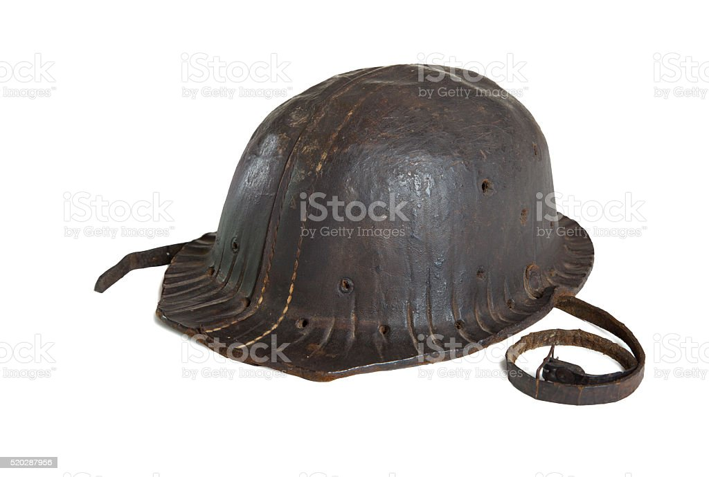 Old mining helmet isolated on white with a clipping path. stock photo