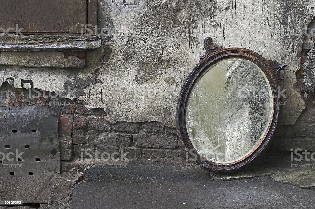 Old Mirror Standing Against Wall royalty-free stock photo