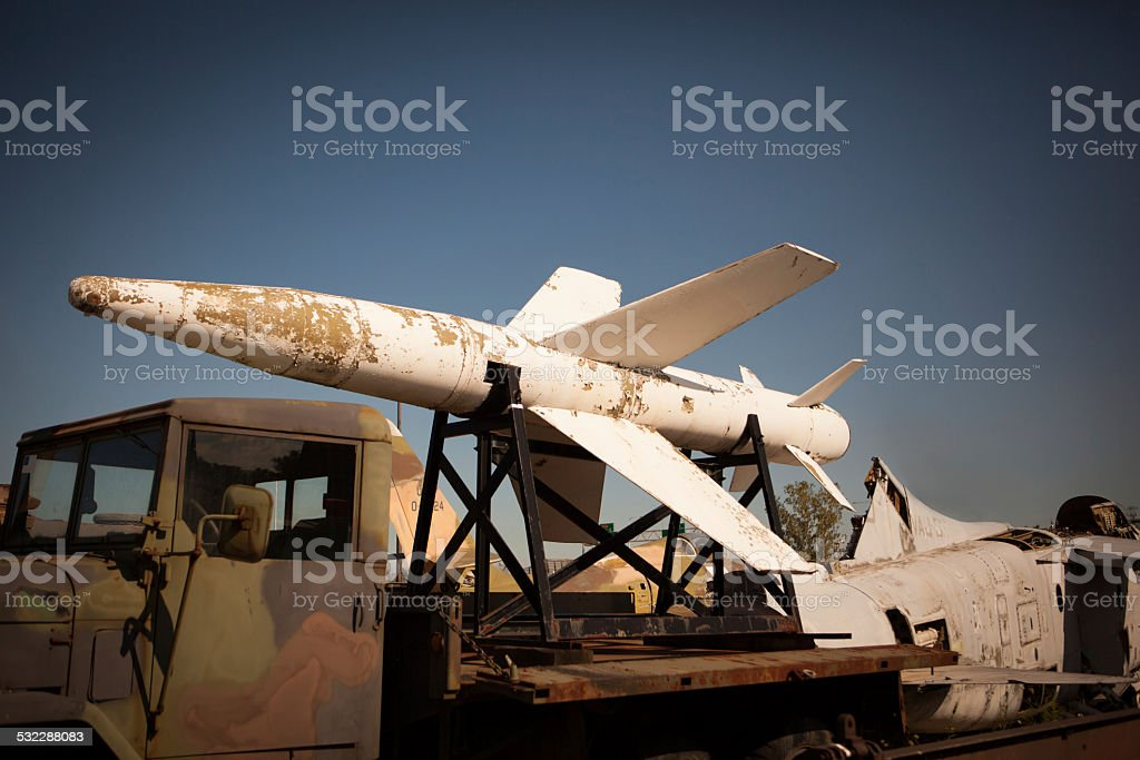 Old missile sitting on a truck in a salvage yard stock photo