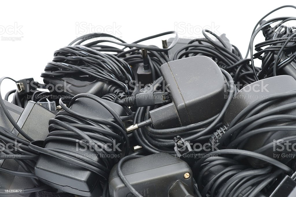 Old mobile phone chargers stock photo