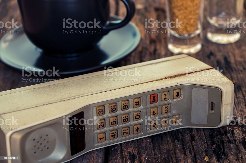 Old mobile phone put on wooden table stock photo
